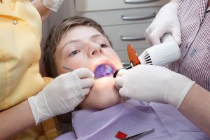 boy at dentist with mouth open
