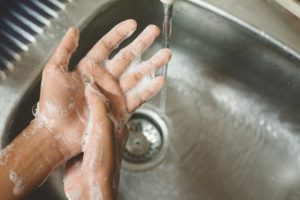dentist washing their hands to prevent COVID-19